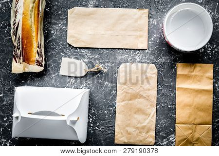 Food Delivery With Paper Bags And Sandwich On Gray Background To