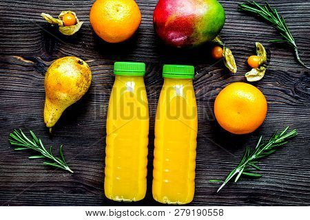Multifruit Drink In Plastic Bottle On Wooden Background Top View