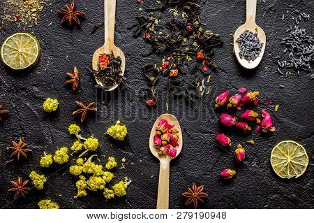 Herbs And Flowers On Spoons Black Background Top View
