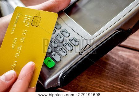 Online Payment Concept With Credit Card And Terminal On Wooden B
