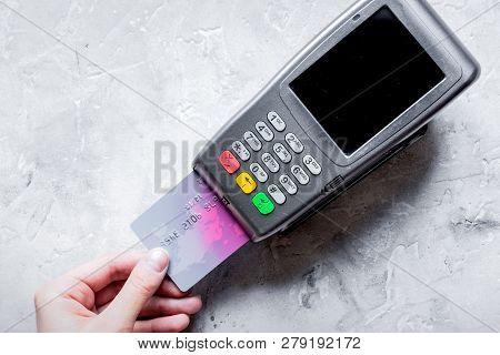 Payment With Credit Card Through Terminal On Stone Background To