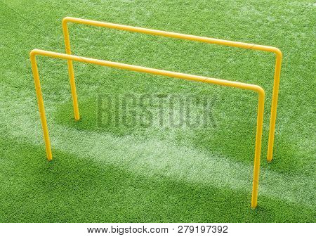 Parallel Bars On An Astroturf Pitch Used For Exercise And Fitness.