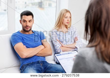 people, relationship difficulties and family therapy concept - couple with problem at psychologist office