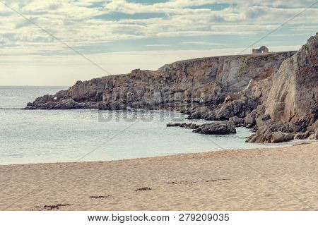 French Landscape - Bretagne. A Beautiful Beach With Wild Cliffs In The Background.