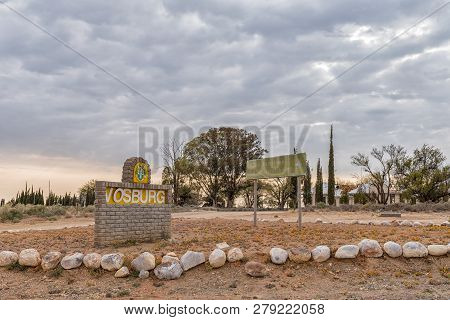 Vosburg, South Africa, September 1, 2018: A Name Board And Directional Sign At The Entrance To Vosbu