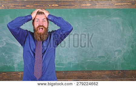 Man bearded teacher or educator hold head chalkboard background. Pay attention to your behaviour and manners. Teacher etiquette tips modern education professional. Teacher behaves unprofessionally poster