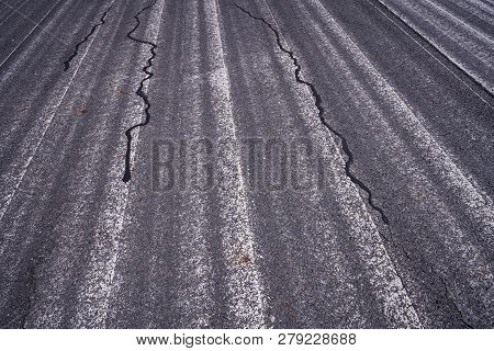 Faded White Road Markings On A Street For Backgrounds