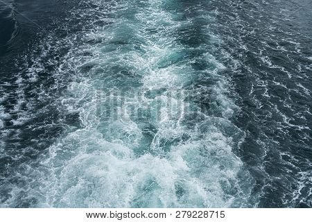 Trail On Water Surface Behind A Ferry On The Ocean