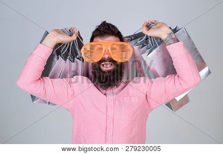Man Bearded Hipster Wear Sunglasses While Carry Lot Shopping Bags. Shopping On Black Friday. Happy S