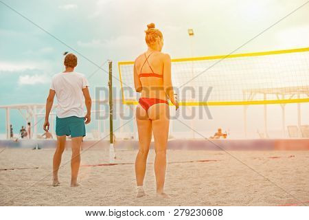 Volleyball Beach Player Is A Female Athlete Volleyball Player Getting Ready To Serve The Ball On The