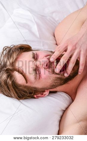 Man handsome guy lay in bed. Get adequate and consistent amount of sleep every night. How much sleep you actually need. Bearded man sleeping face relaxing on pillow. Expert tips on sleeping better poster