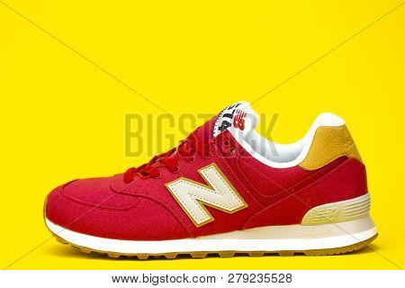 Boston, Ma, Usa, January 2019 - Red New Balance Nb 574 Athletic Shoes On Yellow Studio Background. N