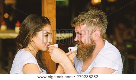 Man With Beard And Attractive Happy Smiling Girl Drinking Coffee. Couple In Love Drink Black Espress