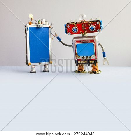 Smartphone And Red Head Robot Assistant. Creative Design Touch Screen Mobile Phone Device, Light Bul