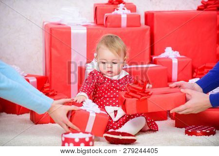Little Baby Girl Play Near Pile Of Gift Boxes. Gifts For Child First Christmas. Celebrate First Chri