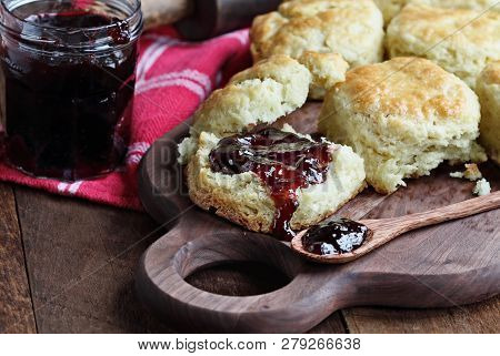 Buttermilk Southern Biscuits Or Scones Served With Homemade Fruit Preserves. Top View.