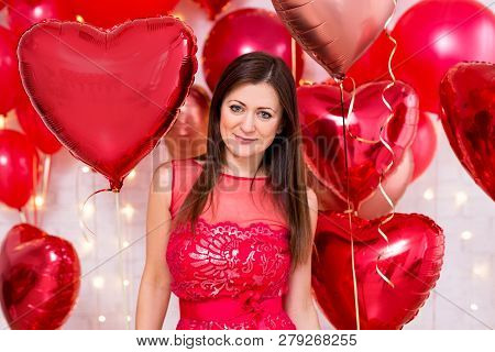 Portrait Of Beautiful Young Woman With Red Heart-shaped Balloons