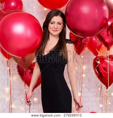 Valentine's Day Concept - Portrait Of Middle Aged Beautiful Woman In Black With Red Balloons