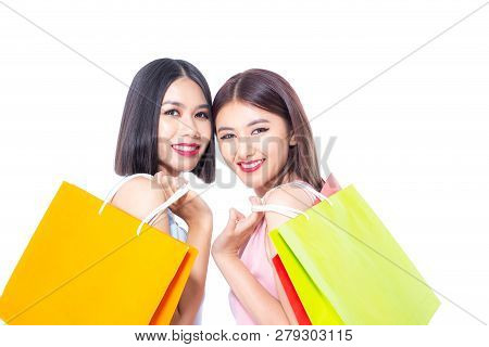 Portrait Of A Happy Asian Beautiful Woman Holding Shopping Bags With Isolated On White Background. P