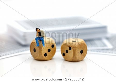 Miniature People: Businessman Standing With Dice And Poker Card.. Concept Of Investment Risks.