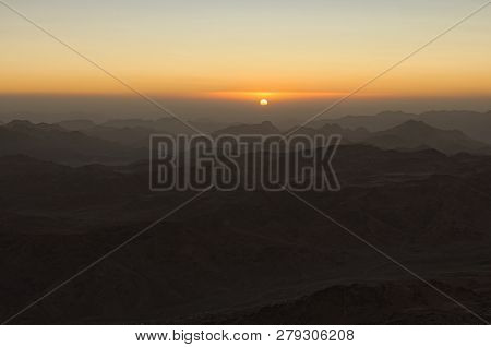 Magic Golden Sunrise In The Mountains. The Sun Comes Out From The Cloud. View From Mount Sinai (moun