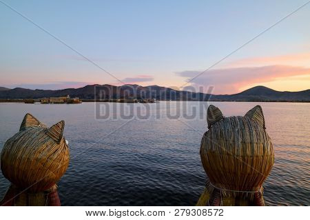 Stunning View Of Lake Titicaca After Sunset As Seen From The Famous Totora Reed Boat With A Pair Of