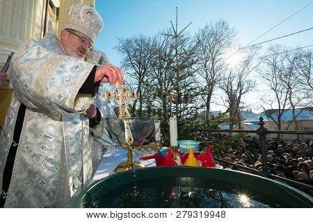 Uzhgorod, Ukraine - Jan 19, 2019: Greek Catholic Epiphany Ceremony In Cathedral. Priest Dipping The