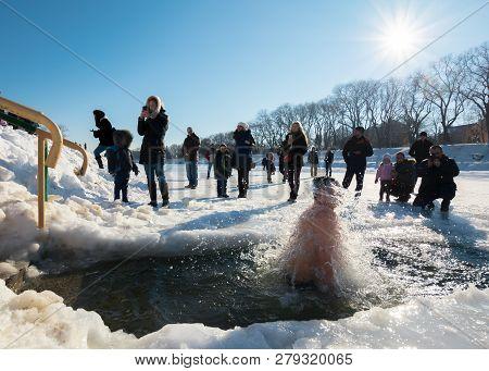 Uzhgorod, Ukraine - Jan 19, 2019: Greek Catholic Epiphany Winter Swimming. Man Take Part In Ice Dipp