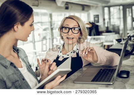 Blonde-haired Owner Of Restaurant Telling Waitress About Schedule