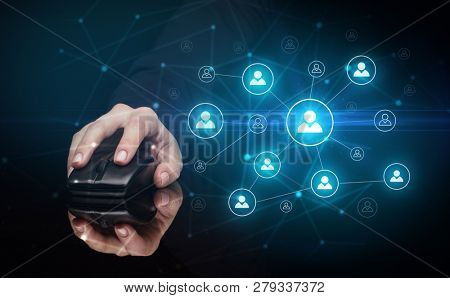 Hand using wireless mouse in a dark environment with human network concept