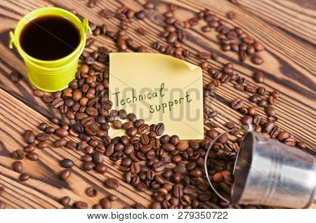 Full Green Metal Bucket Of Black Coffee And Empty Zinked Bucket Near Paper Sticker With Inscription