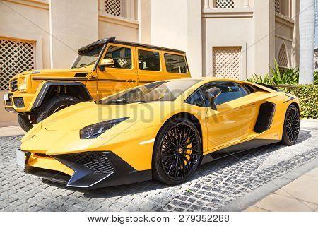 Dubai, Uae - January 08, 2019: Yellow Luxury Supercar Lamborghini Aventador Roadster And Gelandewage