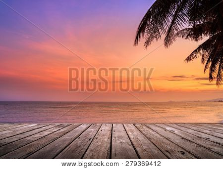 Empty Wooden Terrace Over Tropical Island Beach With Coconut Palm At Sunset Or Sunrise Time