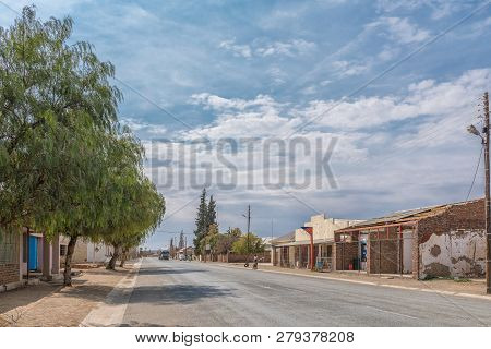 Strydenburg, South Africa, September 1, 2018: A Street Scene, With Businesses, Vehicles And People,