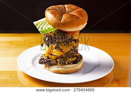 Tower Of Giant Tall Burger. Hamburgers Stack On A Plate