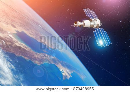 Space Communications Satellite In Orbit Around The Earth. Elements Of This Image Furnished By Nasa