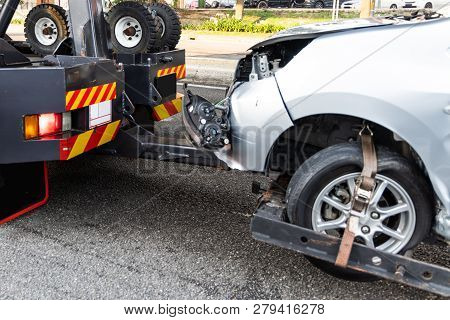 Tow Truck Towing Broken Down Car From Accident On Road