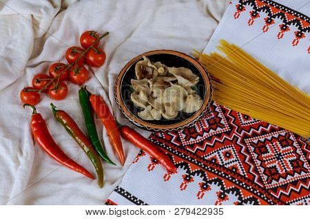 mushrooms pickled and red hoot pepper, red tomatoes in a ukrainian embroidered towel style selective Focus poster