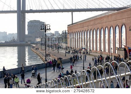 Vladivostok, Russia, Oct, 10, 2017: People Walking On Tsesarevich Quay On Vladivostok In Autumn Day