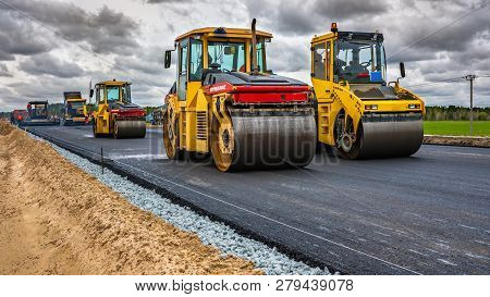 Reconstruction Of The Highway, Tyumen, Russia: May 28, 2018. Roller Compacts Asphalt On Road During