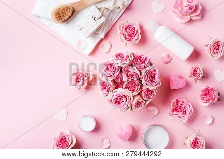Aromatherapy, Spa, Beauty Background With Roses Flowers, Cosmetics And Candles On Pink Table. Flat L