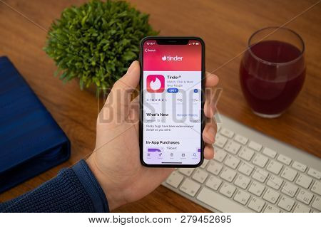 Alushta, Russia - November 4, 2018: Man Hand Holding Iphone X With Social Networking Service Tinder