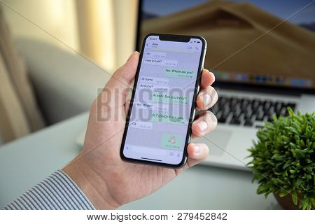Alushta, Russia - October 9, 2018: Man Holding Iphone X With Social Networking Service Whatsapp On T