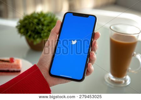 Alushta, Russia - November 6, 2018: Woman Hand Holding Iphone X With Social Networking Service Twitt