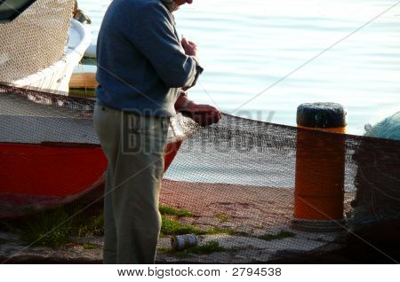 Fisherman And  Fishing Net