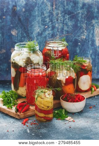 Homemade Pickles Of Different Vegetables In Jars On Rustic Table, Selective Focus