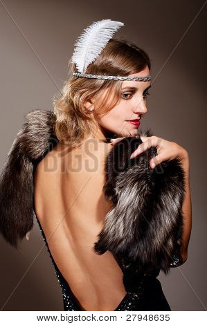 Woman In Evening Dress And Fur