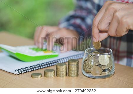 Business Man Putting Coin In Glass Bottle Saving Bank And Account For His Money All In Finance Accou