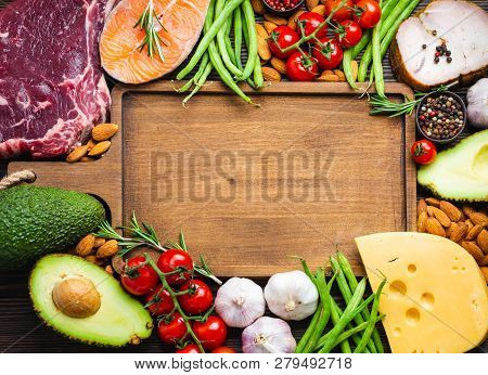 Wooden Cutting Board And Ketogenic Low Carbs Ingredients For Healthy Weight Loss Diet, Top View, Cop