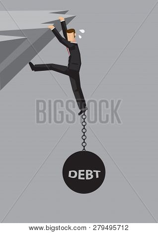 Businessman Hanging Dangerously On Cliff And Weigh Down By Metal Ball And Chain With Word Debt Chain